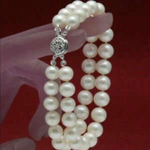 Jewelry - GENUINE DOUBLE STRAND WHITE PEARL BRACELET.